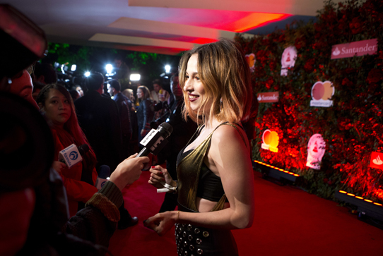 Actress interviewed on red carpet