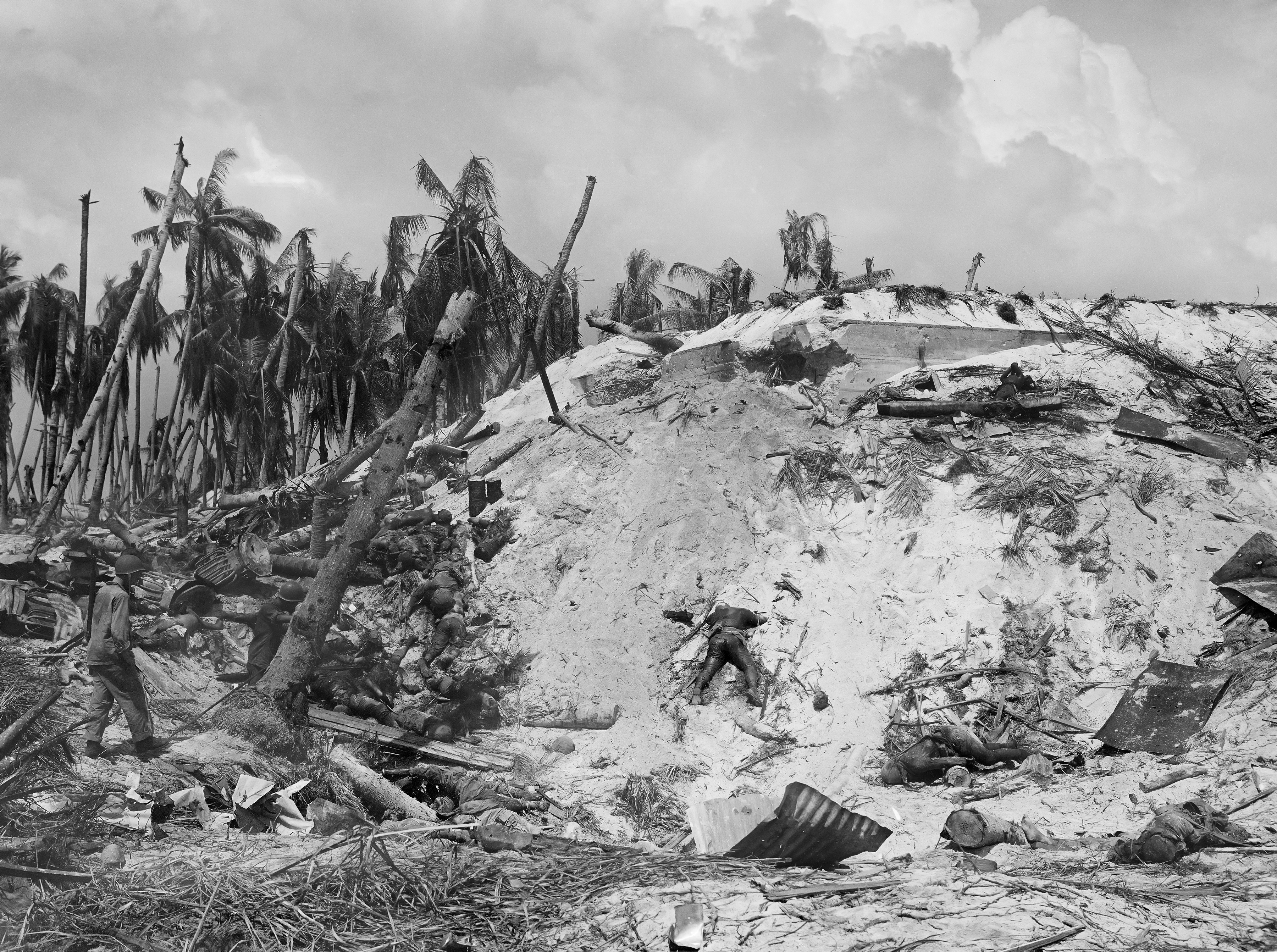 Dead Japanese soldiers lay scattered around a blasted Japanese pillbox on Tarawa Atoll in the Gilbert Islands of the South Pacific on Nov. 11, 1943 during World War II. (AP Photo/Frank Filan)