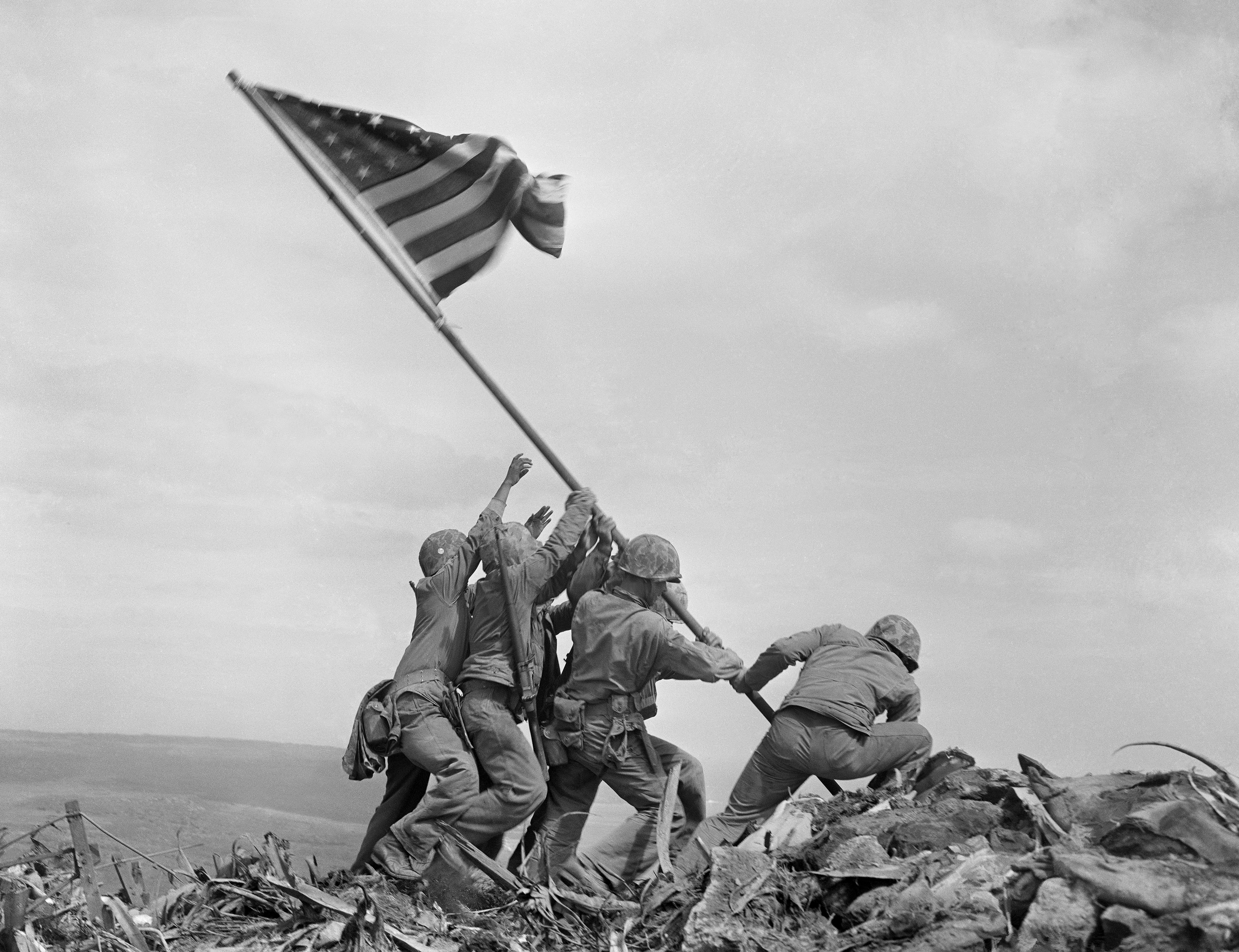 U.S. Marines raise a second, larger American flag atop Mt. Suribachi on the Japanese Island of Iwo Jima, Feb. 23, 1945. Three of the men in the photo were later killed in fighting on the island. This is the only photo to win the Pulitzer Prize in the year it was shot. (AP Photo/Joe Rosenthal)