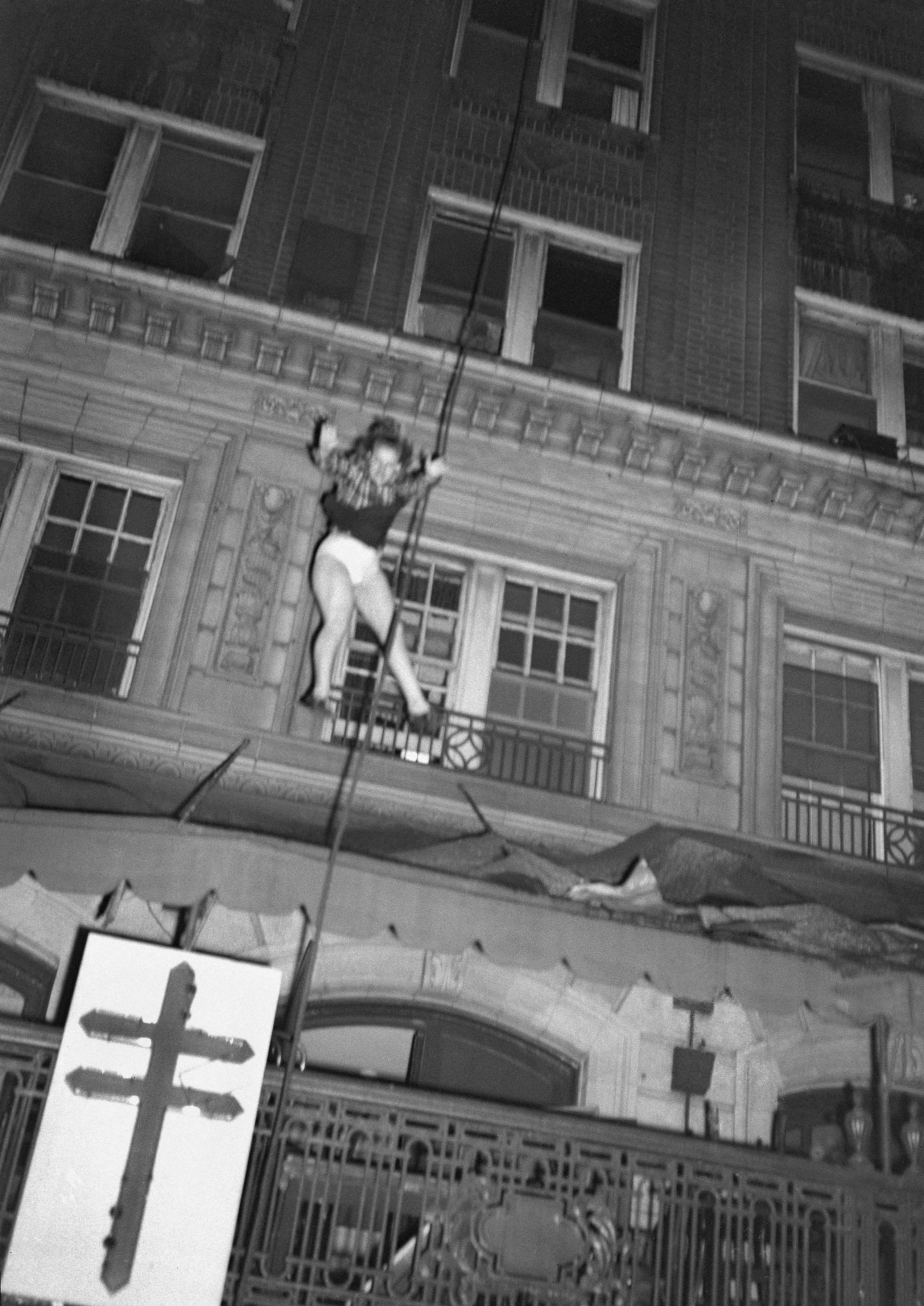A woman plunges from the upper floors of Atlanta's Winecoff Hotel as a fire traps many occupants, Dec. 7, 1946. The woman was reported to have survived after her fall was broken by part of the hotel marquee. The fire killed 119 people, including he hotel's owners. (Arnold Hardy via AP)