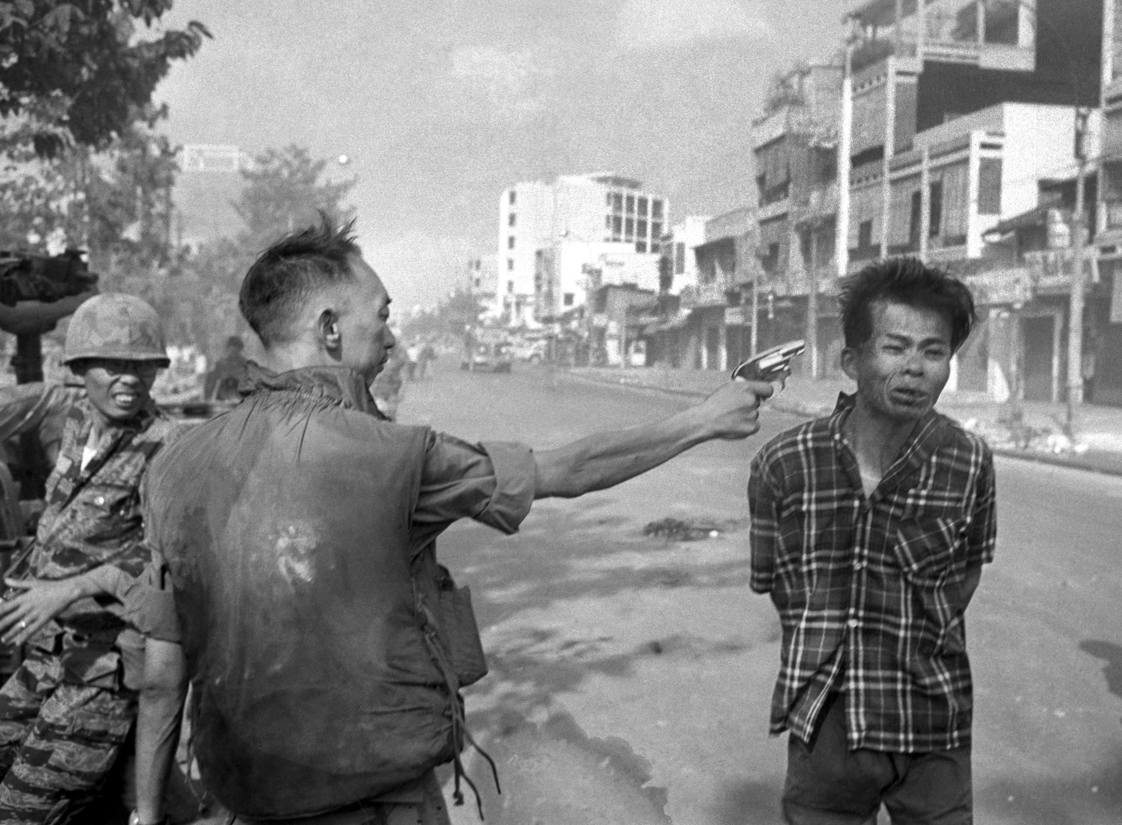 South Vietnamese Gen. Nguyen Ngoc Loan, chief of the national police, fires his pistol into the head of suspected Viet Cong officer Nguyen Van Lem (also known as Bay Lop) on a Saigon street Feb. 1, 1968, early in the Tet Offensive. The general said Nguyen Van Lem was responsible for numerous Vietnamese and American deaths. (AP Photo/Eddie Adams)