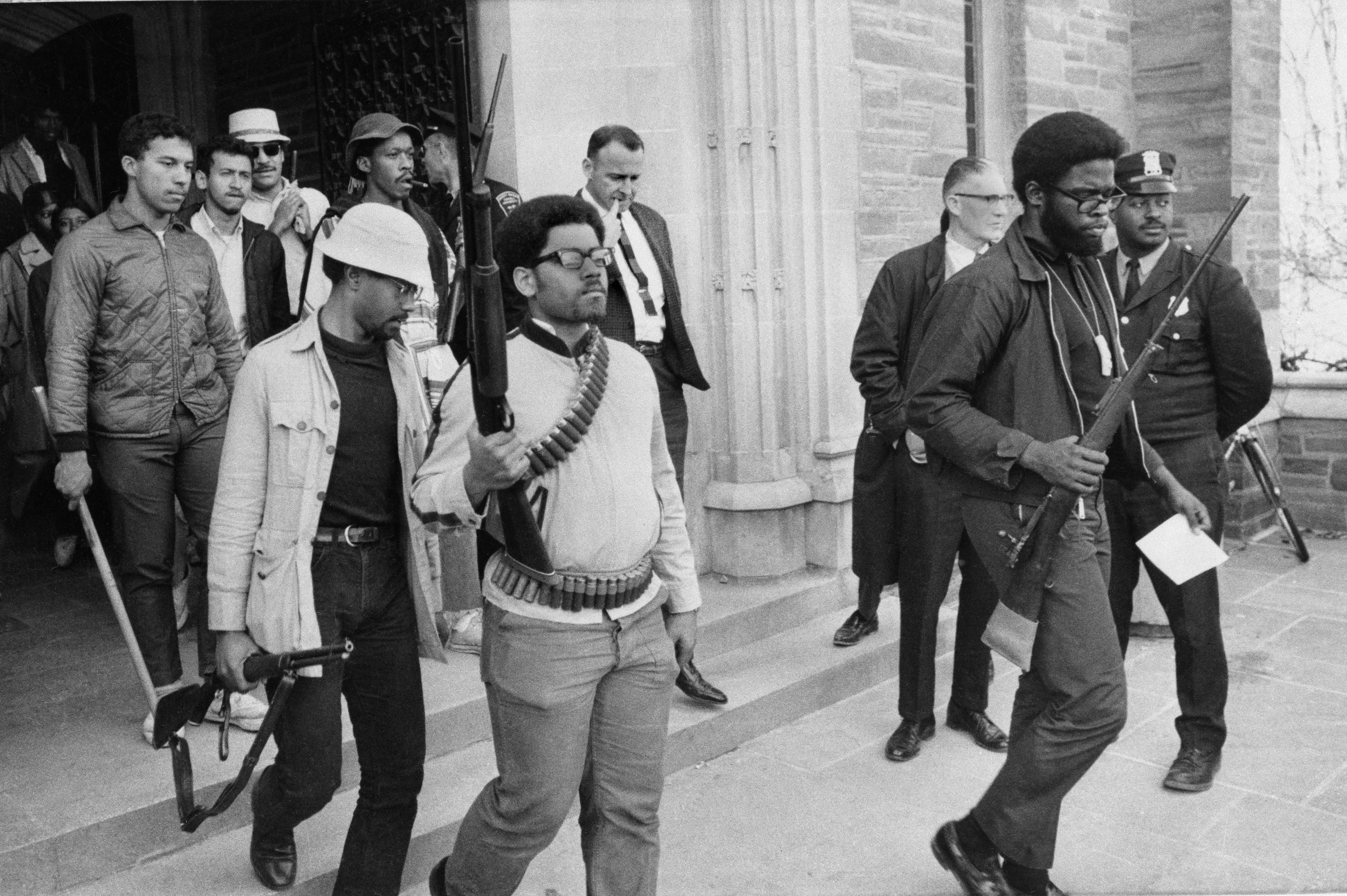 Armed students led by Ed Whitfield, far right, leave Straight Hall at Cornell University in Ithaca, N.Y., after a 36-hour sit-in, April 20, 1969. The students had barricaded themselves in the building demanding a degree-granting African American studies program. University administrators offered to drop some charges against the students and accelerate the opening of an African-American studies center. (AP Photo/Steve Starr)