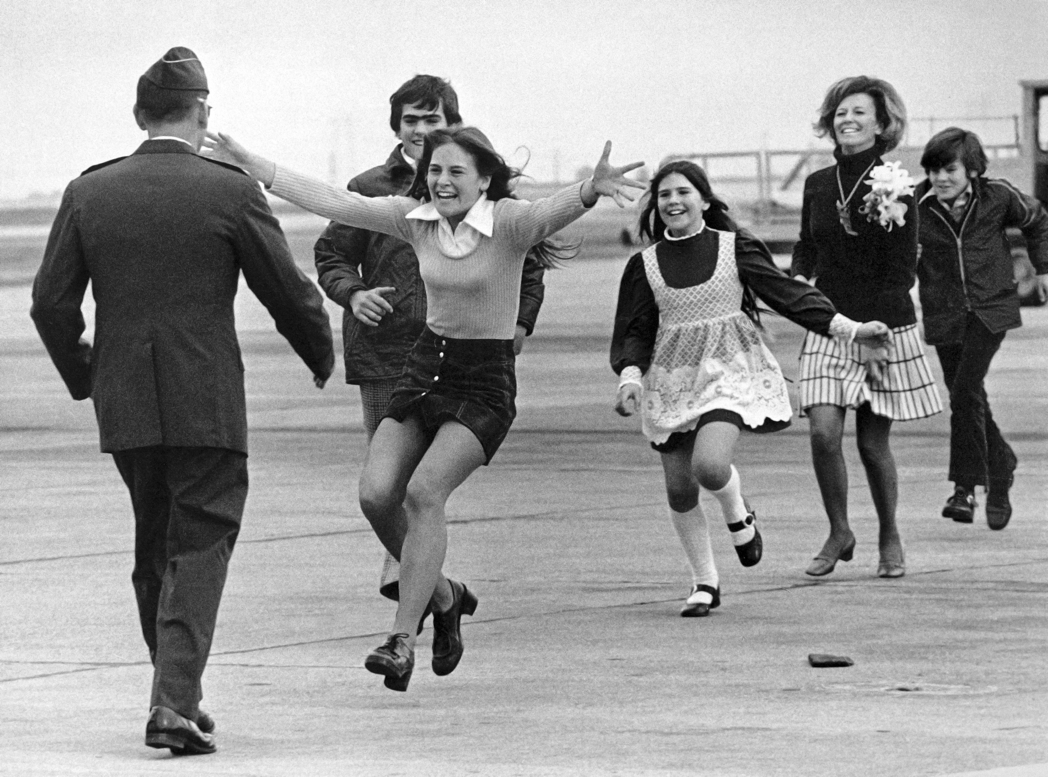 Released prisoner of war Lt. Col. Robert L. Stirm is greeted by his family at Travis Air Force Base in Fairfield, Calif., as he returns home from the Vietnam War, March 17, 1973. Leading is Stirm's daughter Lori, 15, followed by son Robert, 14; daughter Cynthia, 11; wife Loretta and son Roger, 12. Stirm was held more than five years after his plane was shot down over North Vietnam in 1968. (AP Photo/Sal Veder)