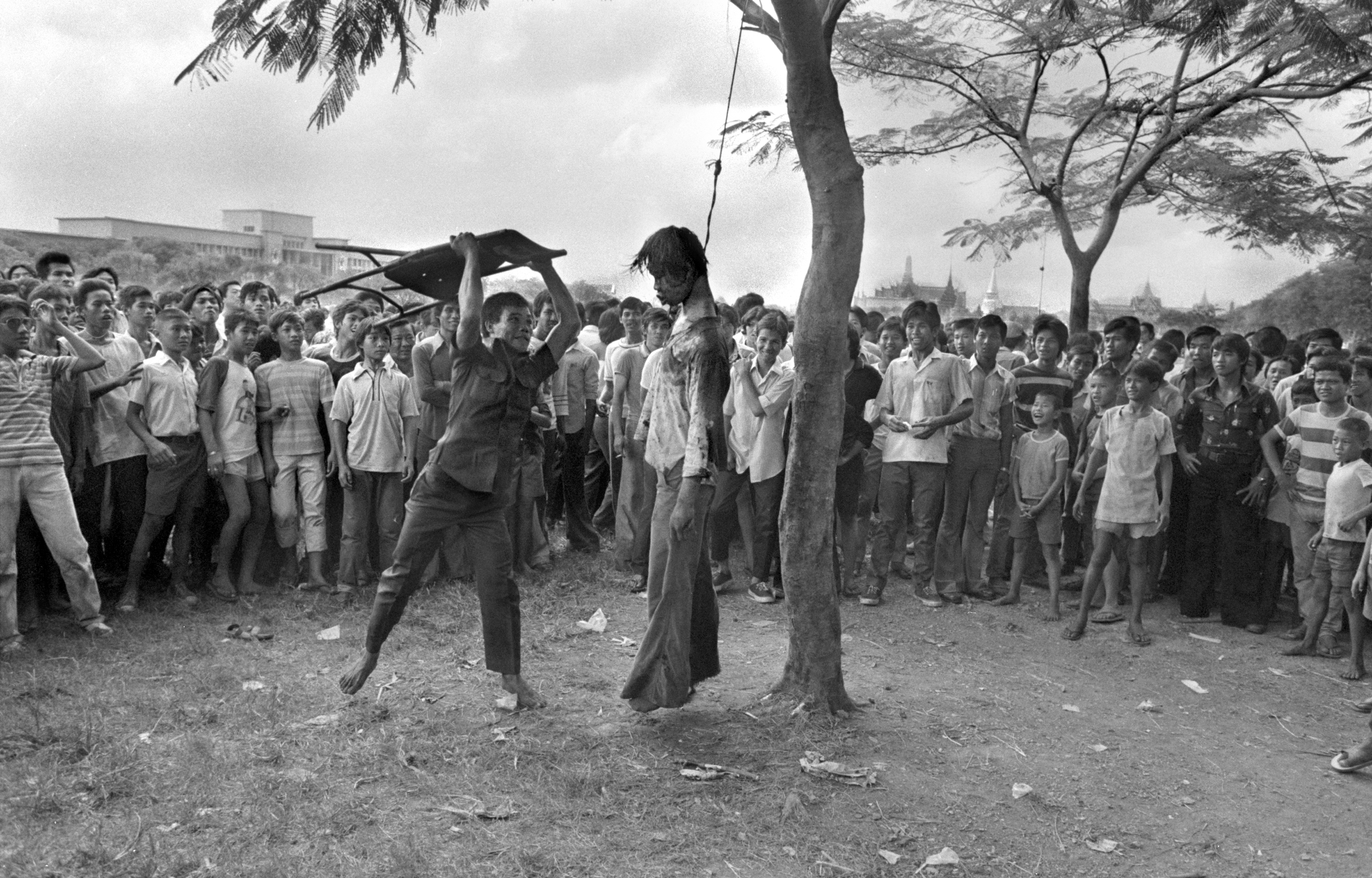 A right-wing supporter strikes the lifeless body of a hanged student outside Thammasat University in Bangkok, Oct. 6, 1976. Police stormed the university after students demanded expulsion of a former military ruler and barricaded themselves in the school. (AP Photo/Neal Ulevich)
