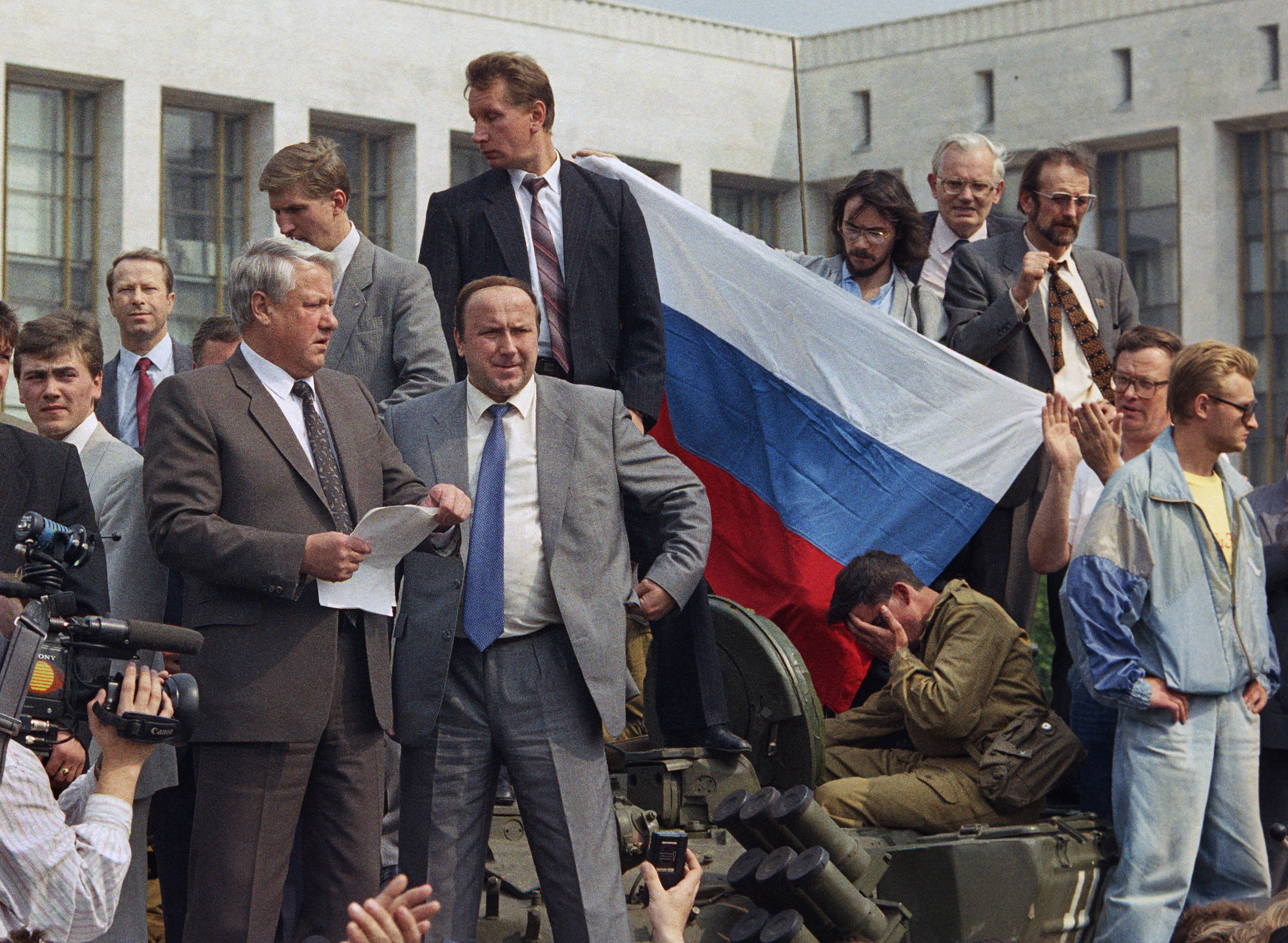 Boris Yeltsin, president of the Russian Federation, makes a speech from atop a tank in front of the Russian parliament building in Moscow, U.S.S.R., Monday, Aug. 19, 1991. Yeltsin called on the Russian people to resist the communist hard liners in the Soviet coup. (AP Photo)