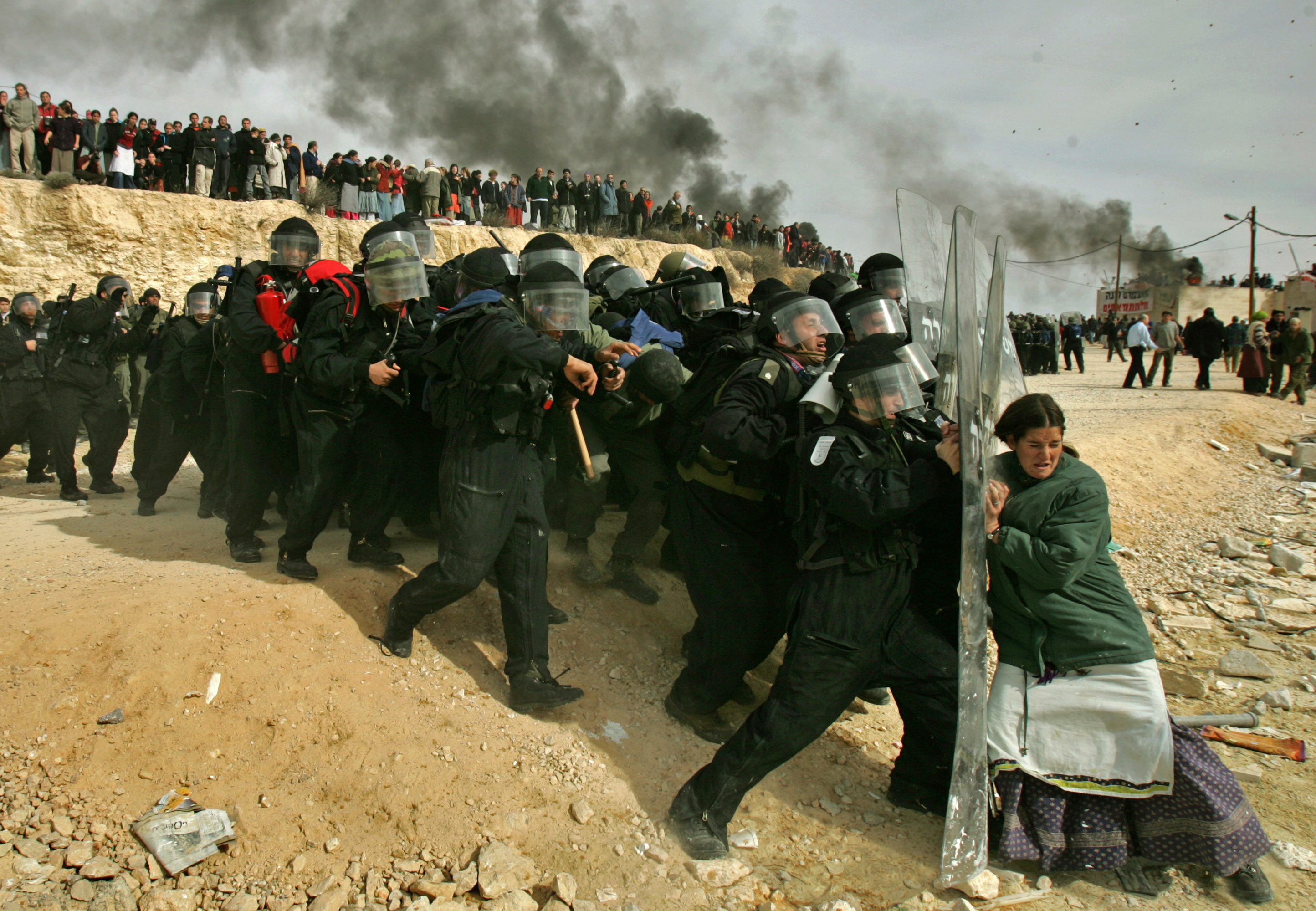 pulitzer prizes won by the  a lone jewish settler challenges i security officers during clashes that erupted as authorities cleared the west bank settlement of amona east of the