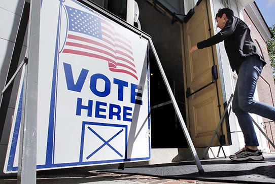A resident arrives to cast her vote at a polling station at the Town Hall in Kennebunk, Maine.