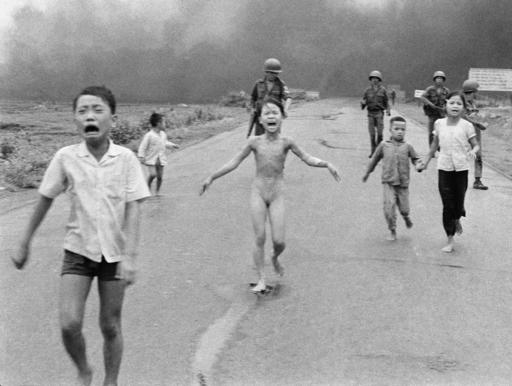 South Vietnamese forces follow terrified children, including 9-year-old Kim Phuc, center, as they run down Route 1 near Trang Bang after an aerial napalm attack in Vietnam, June 8, 1972. (AP Photo/Nick Ut)