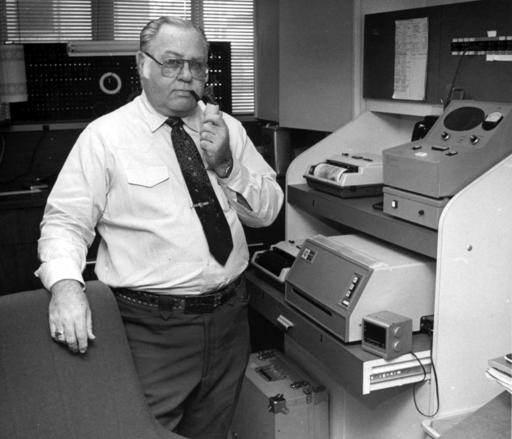 This Feb. 15, 1985 file photo shows former AP photographer Ed Kolenovsky transmitting photos at the bureau office in Houston. (AP Photo)