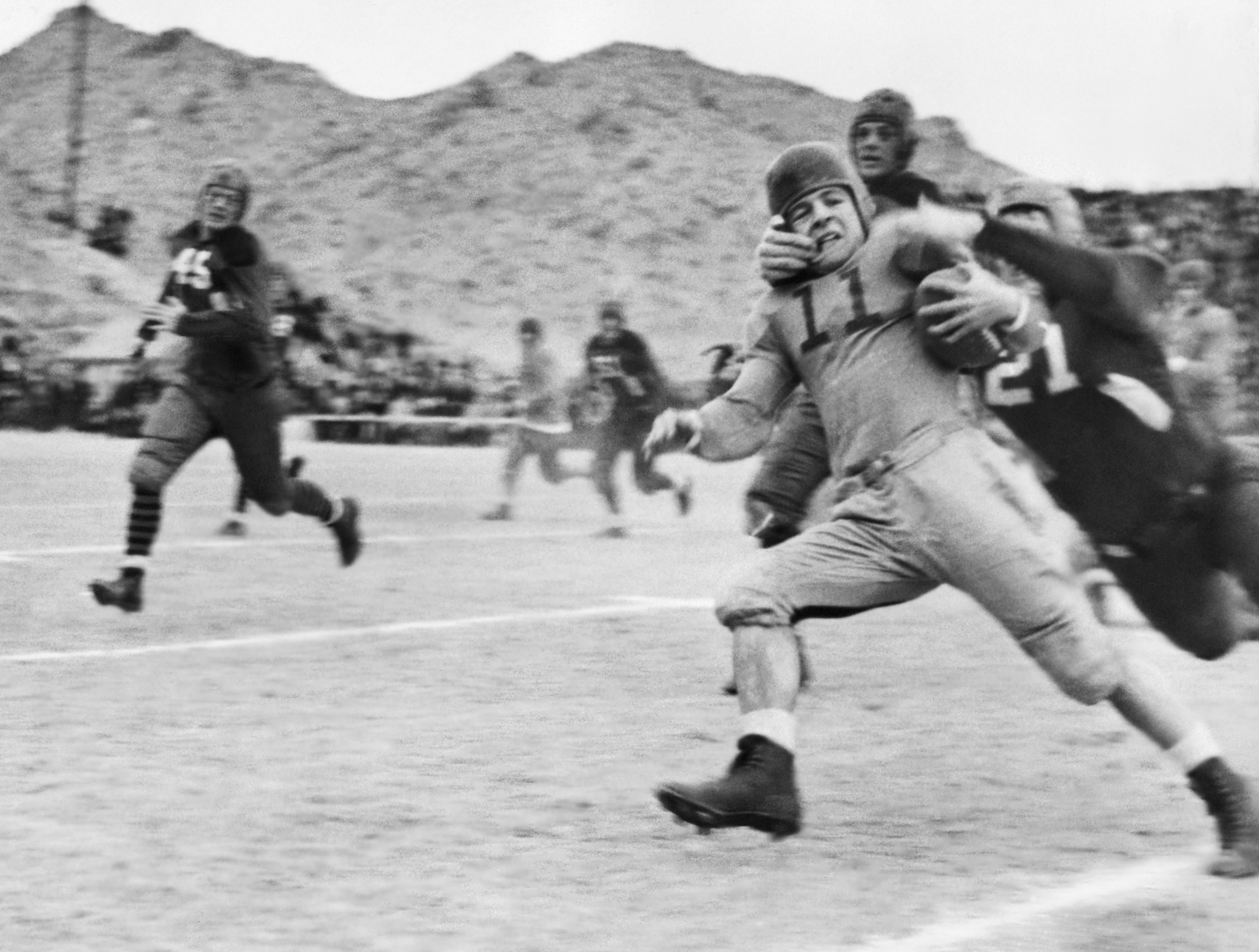 This photo, from the close of the first season of the AP poll, shows Texas Tech's famed Elmer Tarbox, No. 21, at extreme right, giving the well-known neck tie tackle at the Sun Bowl in El Paso, Texas, on Jan. 2, 1937. (AP Photo)