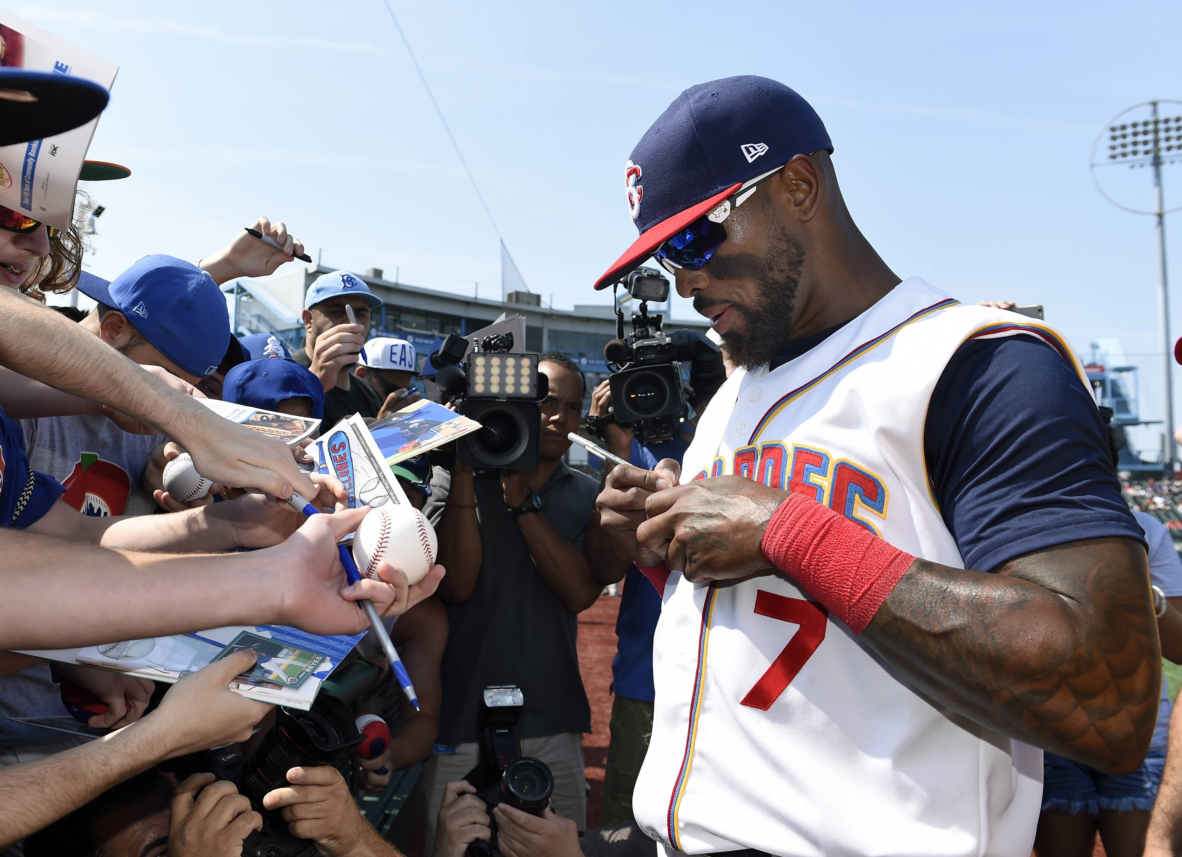 Jose Reyes, who agreed to a Minor League contract with the New York Mets, signs autographs Sunday after joining the team's affiliated Brooklyn Cyclones. The Cyclones' games are being reported by AP in an expansion of Minor League coverage. (AP Photo/Kathy Kmonicek)