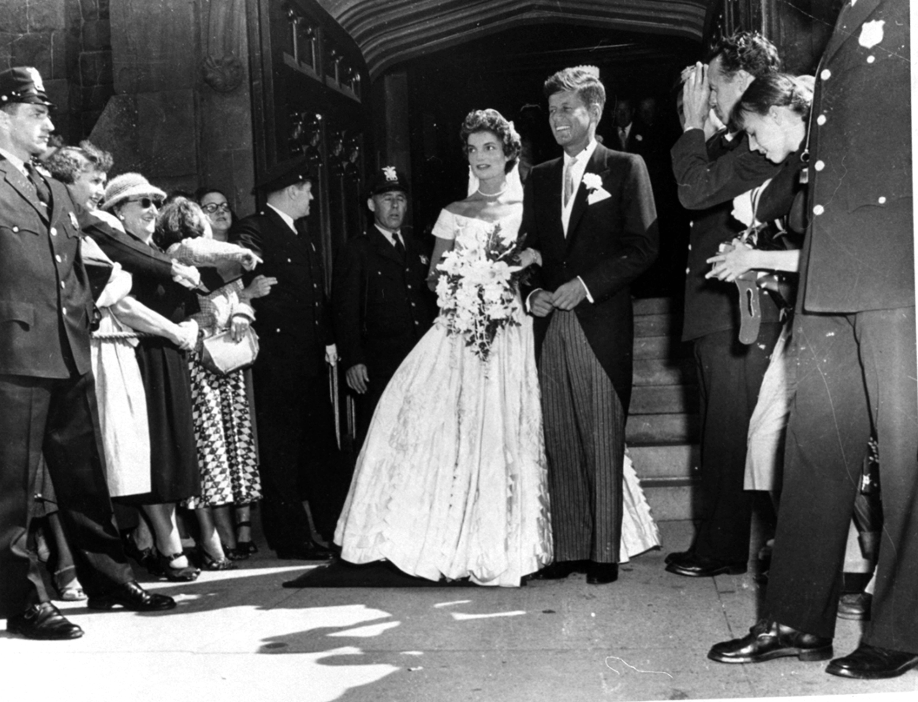 Archival and breaking-news images from AP are part of its new distribution agreement with Shutterstock Editorial. Above, Sen. John F. Kennedy, D-Mass., is shown with his bride, the former Jacqueline Bouvier, leaving a Newport, Rhode Island church after their wedding on Sept. 12, 1953. (AP Photo) Below, New England Patriots quarterback Tom Brady, left, and Denver Broncos quarterback Peyton Manning speak following the AFC championship game Sunday, Jan. 24, 2016, in Denver. (AP Photo/David Zalubowski)