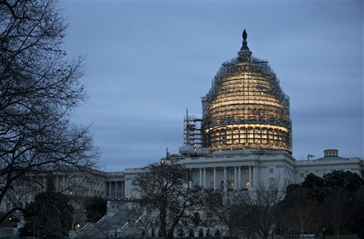 The Capitol dome is illuminated amid scaffolding for repairs in Washington, Friday morning, Dec. 18, 2015. How the nation votes and the resulting balance of power in Congress will be addressed by AP's new product for radio stations. (AP Photo/J. Scott Applewhite)