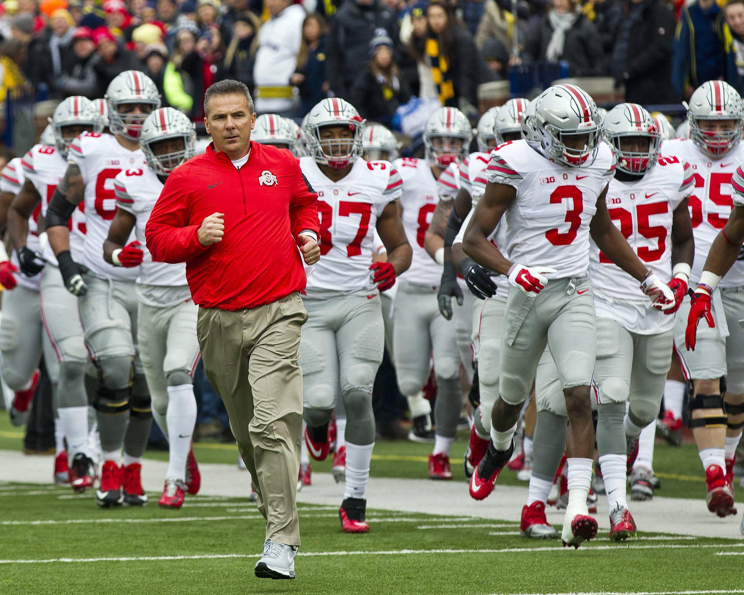 Last year's top-ranked team in the AP Top 25 preseason poll was Ohio State University, whose head coach, Urban Meyer, is seen here leading his team onto the field before playing the University of Michigan in Ann Arbor, Michigan, Nov. 28, 2015. (AP Photo/Tony Ding)