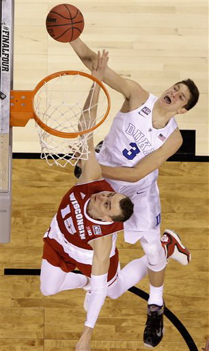 Duke's Grayson Allen (3) shoots against Wisconsin's Sam Dekker (15) during the second half of the NCAA Final Four college basketball tournament championship game Monday, April 6, 2015, in Indianapolis. (AP Photo/David J. Phillip)