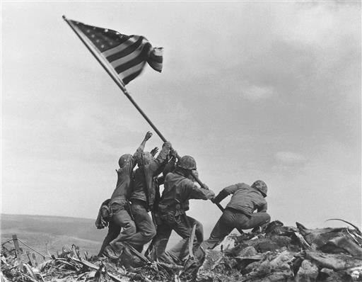 Pulitzer Prize-winning photo taken by Joe Rosenthal in 1945 shows U.S. Marines of the 28th Regiment, 5th Division, raising the American flag atop Mt. Suribachi, Iwo Jima, Japan. (AP Photo/Joe Rosenthal)