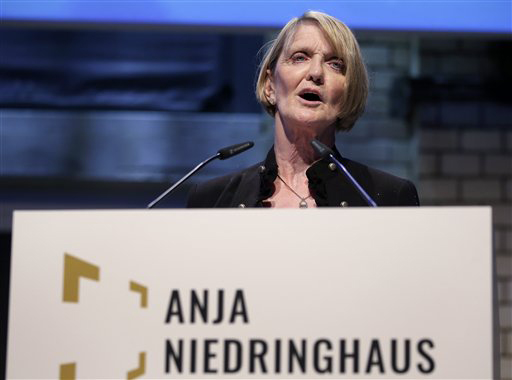 AP's special regional correspondent for Pakistan and Afghanistan, Kathy Gannon, speaks at the gathering in Berlin to present the Anja Niedringhaus Courage in Photojournalism Award to Heidi Levine. Gannon was wounded by the same gunman who killed Niedringhaus last year in Afghanistan. (AP Photo/Michael Sohn)
