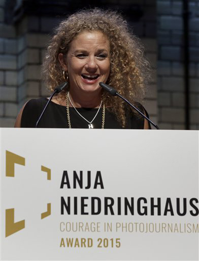 Photographer Heidi Levine, winner of the first Anja Niedringhaus Courage in Photojournalism Award, speaks during the ceremony in Berlin, Thursday, June 25, 2015. The award was created to honor the life and work of Pulitzer Prize-winning AP photographer Anja Niedringhaus (1965-2014). (AP Photo/Michael Sohn)
