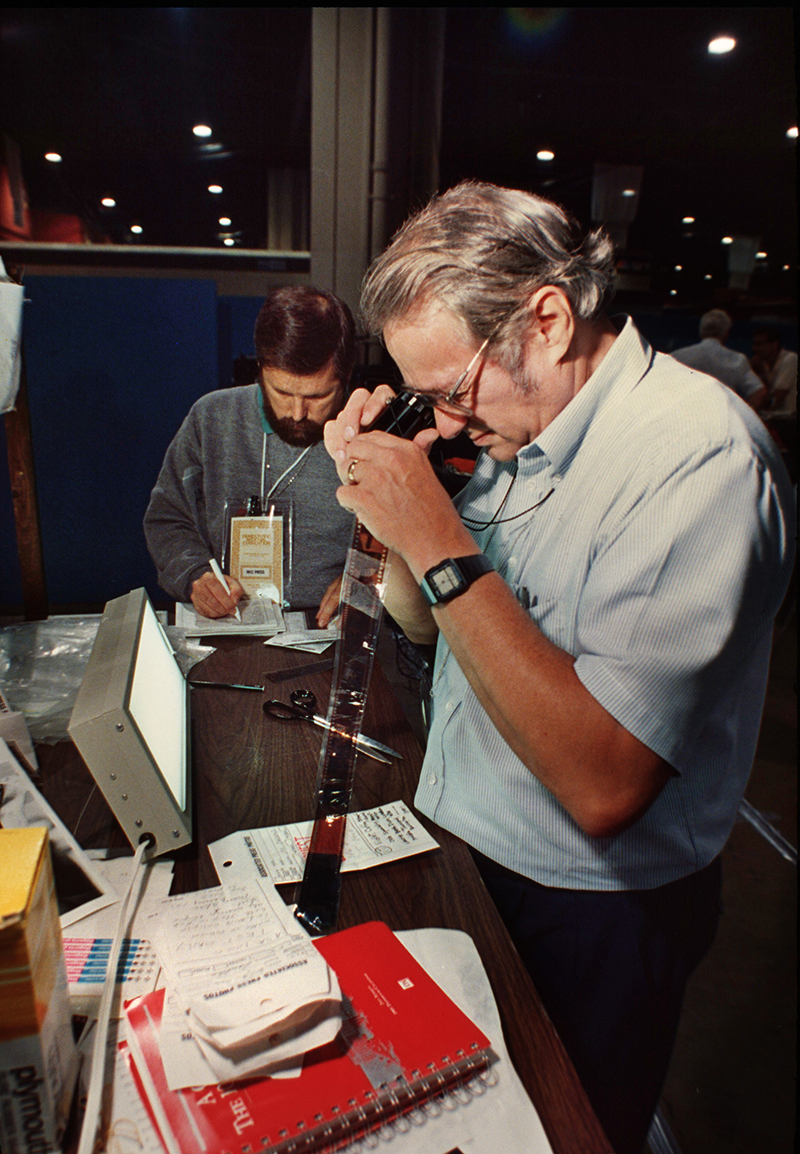 Toby Massey, right, and New York Senior Photo Editor Brian Horton handle film during the Democratic National Convention in Atlanta, 1988. (AP Photo)