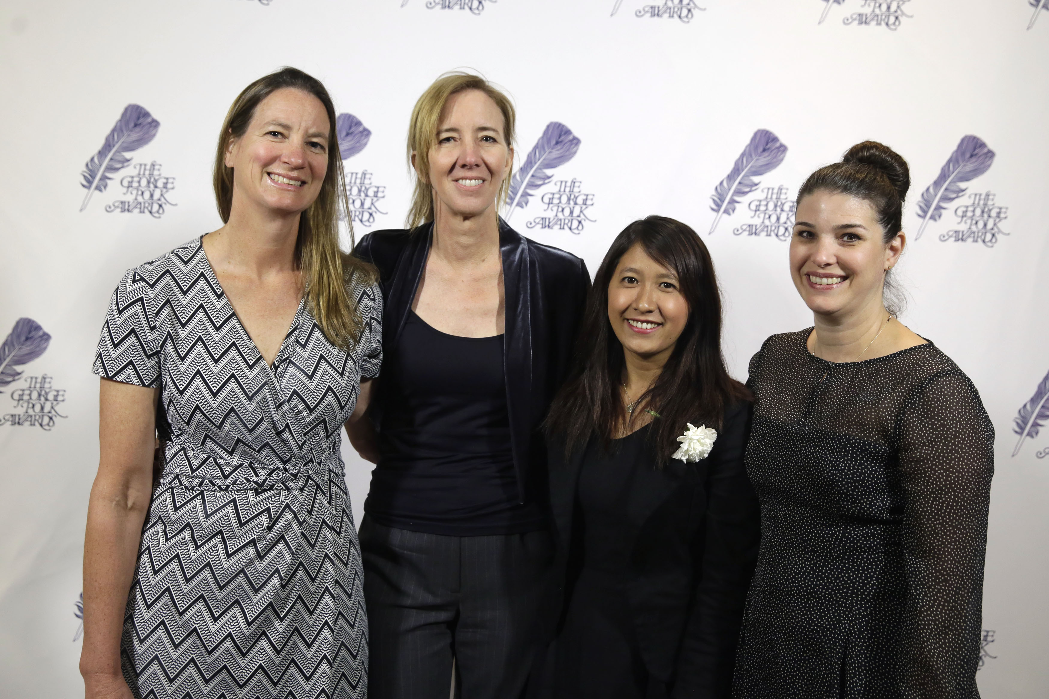 The AP team that investigated seafood caught by slaves poses at the George Polk Awards luncheon in New York,  Friday, April 8, 2016. From left: Martha Mendoza, Robin McDowell, Esther Htusan and Margie Mason. (AP Photo/Richard Drew)