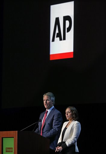 Gary Pruitt, left, president and CEO of The Associated Press, and Julie Pace, AP's chief White House correspondent, take questions after speaking to editors and publishers at the Newspaper Association of America's mediaXchange 2014 convention in Denver, Tuesday, March 18, 2014. (AP Photo/Brennan Linsley)