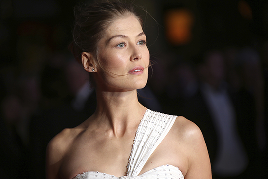 Actress Rosamund Pike poses for photographers on the red carpet for 'A United Kingdom'