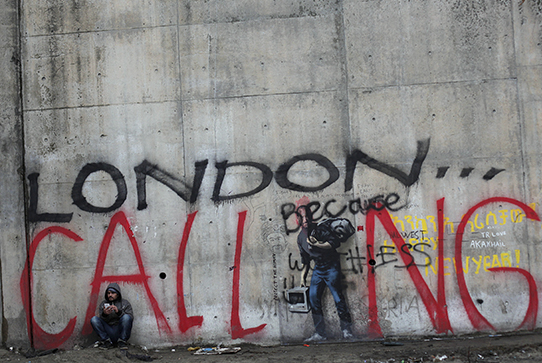 A cement wall with graffiti that says London Calling
