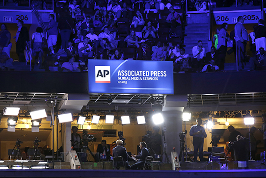 AP Global Media Services billboard at convention