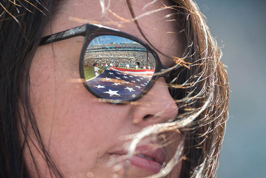 American flag is reflected in a volunteer's sunglasses.