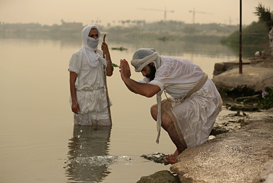 Mandaean religious sect followers perform rituals
