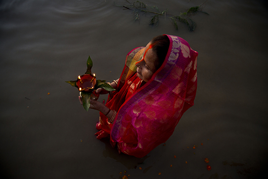 An Indian Hindu devotee performs rituals in the river Brahmaputra during Chhath Puja festival in in Gauhati, India, Saturday, Nov. 2, 2019. During Chhath, an ancient Hindu festival, rituals are performed to thank the Sun god for sustaining life on earth. (AP Photo/Anupam Nath)
