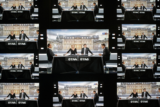 Screens showing the French presidential candidate debate of 2012