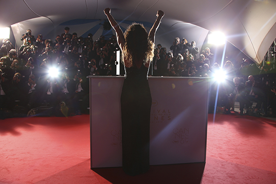 Actress being photographed on red carpet