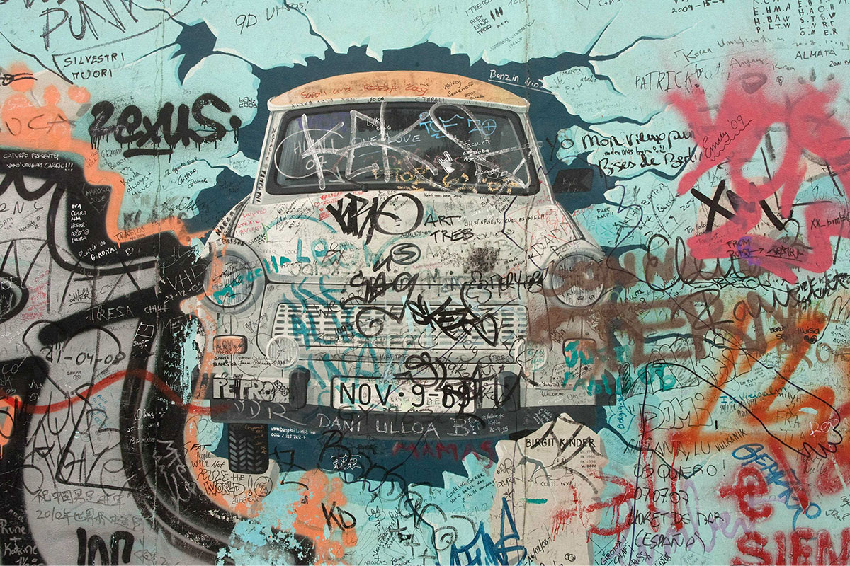 In This Painting By Artist Birgit Kinder, The East German Trabant Crashes  Through The Berlin