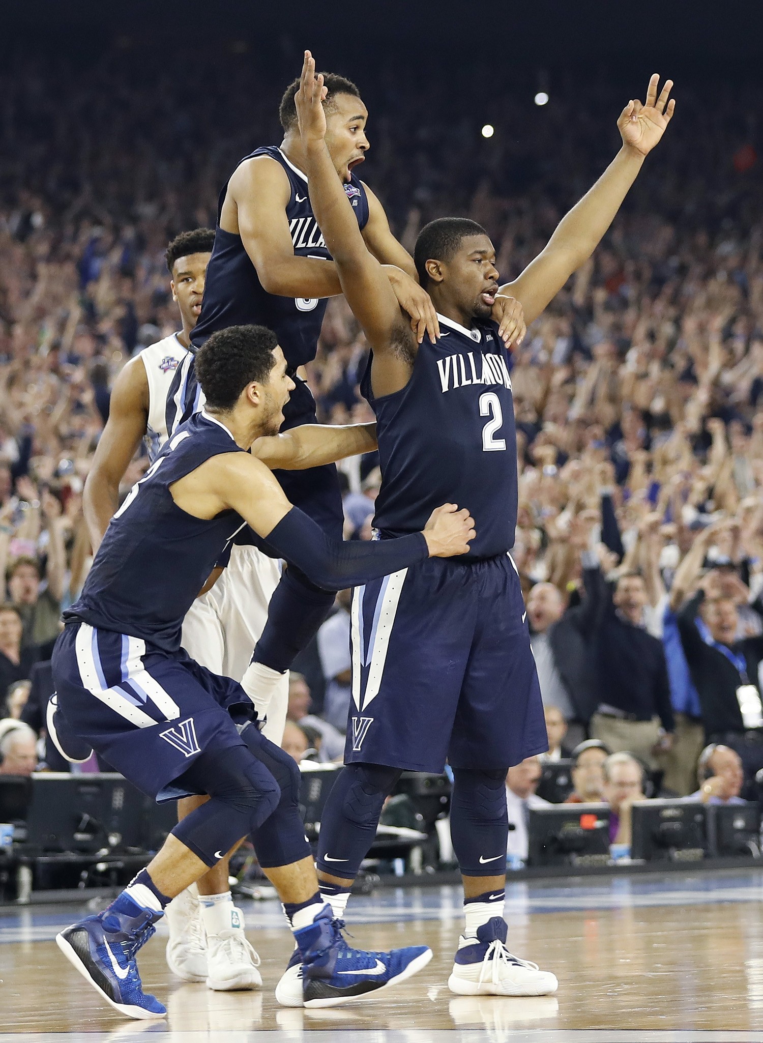 Villanova forward Kris Jenkins (2) celebrates with teammates after the NCAA Final Four tournament college basketball championship game against North Carolina in Houston, April 4, 2016. (AP Photo/Eric Gay)